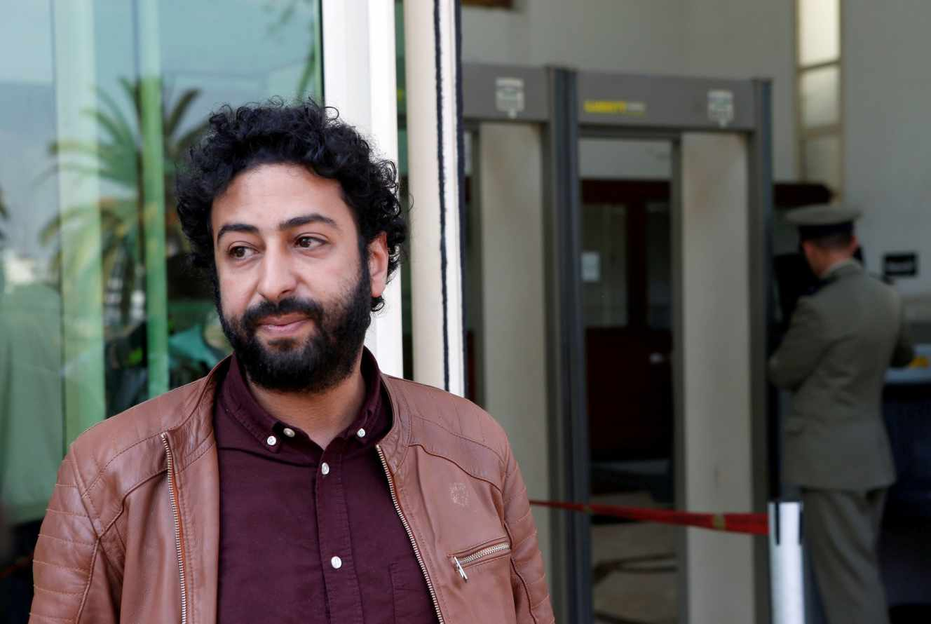 FILE PHOTO: Journalist and activist Omar Radi waits outside court in Casablanca, Morocco March 12, 2020. REUTERS/Youssef Boudlal/File Photo